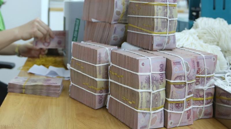 Ngân hàng Nhà nước đã bơm ròng 15.200 tỷ đồng ra thị trường trong phiên hôm qua thông qua nghiệp vụ thị trường mở - Ảnh: Quang Phúc.