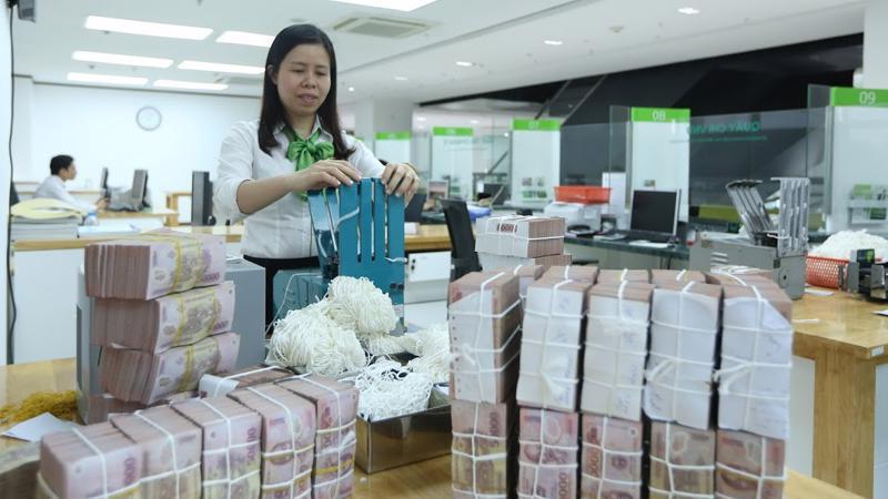 Ngân hàng Nhà nước đã bơm ròng 46.414 tỷ đồng ra thị trường qua nghiệp vụ thị trường mở trong tuần qua - Ảnh: Quang Phúc.