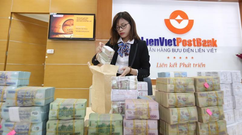 Năm 2018, Ngân hàng Nhà nước thực hiện cơ chế giao chỉ tiêu tăng trưởng tín dụng cho từng thành viên chặt chẽ hơn so với những năm trước - Ảnh: Quang Phúc.