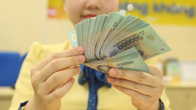 Ước tính đến cuối tháng 12/2018, toàn hệ thống các tổ chức tín dụng đã xử lý được 149,22 nghìn tỷ đồng nợ xấu - Ảnh: Quang Phúc.
