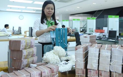 Ngân hàng Nhà nước cho biết, thực tế thanh khoản của cả hệ thống ngân hàng hiện vẫn đang trong trạng thái khá dồi dào - Ảnh: Quang Phúc.<br>