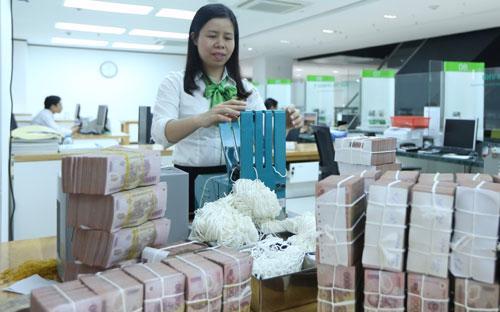 Tính đến đầu tuần này, lượng tín phiếu của Ngân hàng Nhà nước đang lưu hành đã lên tới gần 54.000 tỷ đồng - Ảnh: Quang Phúc.<br>