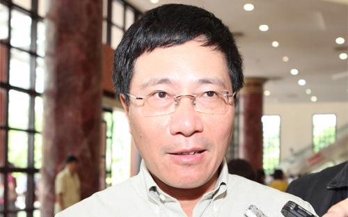 """Bộ trưởng Phạm Bình Minh: """"Đối với các tranh chấp trên biển Đông thì lập trường của Chính phủ rất rõ  ràng là phải giải quyết thông qua hòa bình, đối thoại, tôn trọng Công  ước Luật Biển của Liên hiệp quốc""""."""