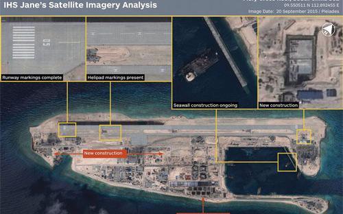 Hình ảnh chụp từ vệ tinh cho thấy hoạt động xây dựng của Trung Quốc ở  bãi Chữ Thập thuộc quần đảo Trường Sa của Việt Nam - Ảnh: IHS  Jane's/WSJ.