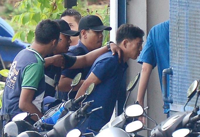 Nghi phạm Ri Jong Chon bị cảnh sát Malaysia bắt giữ hôm 18/2 - Ảnh: Reuters.<br>