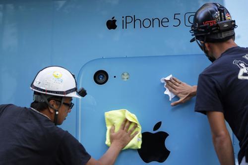 Apple đã có cơ hội tiếp cận với hàng trăm triệu người dùng của nhà mạng lớn nhất Trung Quốc China Mobile - Ảnh: Bloomberg.<br>