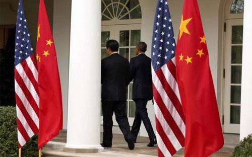 Chủ tịch Trung Quốc Tập Cận Bình (trái) và Tổng thống Mỹ Barack Obama sau một cuộc họp báo chung tại Vườn Hồng, Nhà Trắng trong chuyến thăm Washington của ông Tập hồi tháng 9/2015 - Ảnh: Reuters.<br>