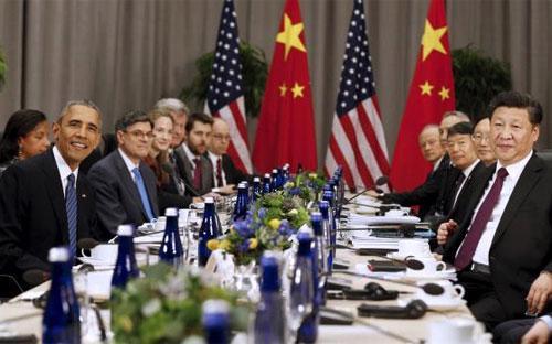 Tổng thống Mỹ Barack Obama (trái) và Chủ tịch Trung Quốc Tập Cận Bình (phải) trong cuộc gặp tại hội nghị thượng đỉnh an ninh hạt nhân ở Washington, Mỹ ngày 31/3 - Ảnh: Reuters.<br>