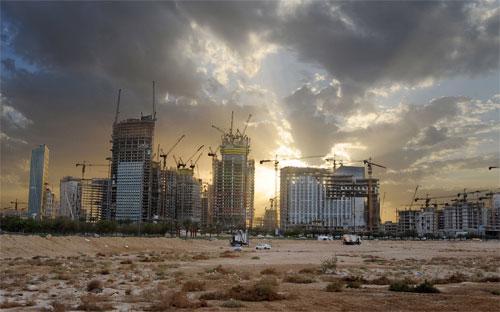 Một dự án xây dựng ở Saudi Arabia - Ảnh: Bloomberg.<br>