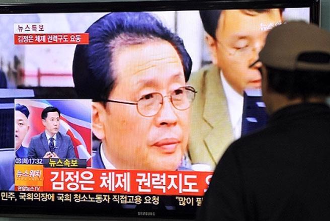 Một bản tin về ông Jang Song Thaek phát trên truyền hình Hàn Quốc - Ảnh: AFP.<br>