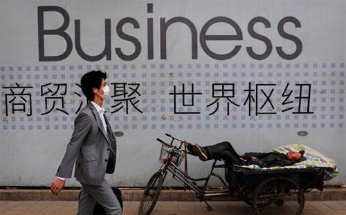Dự báo mà ADB đưa ra tương ứng với cận dưới của mục tiêu tăng trưởng GDP 6,5-7% mà Bắc Kinh đề ra cho năm 2016 - Ảnh: NYT/AP.<br>