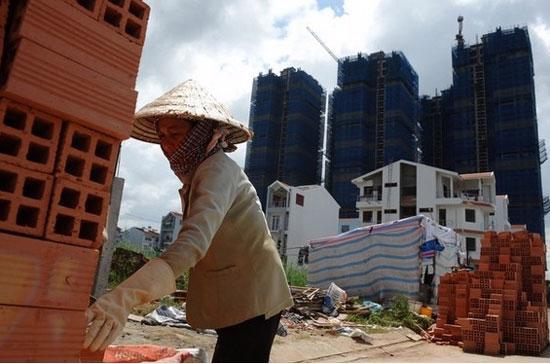 Năng suất lao động xã hội của Việt Nam năm 2010 đạt 40,3 triệu đồng/người, chỉ tương đương với 2.067 USD, thấp xa so với các con số tương ứng của một số nước - Ảnh: Getty.