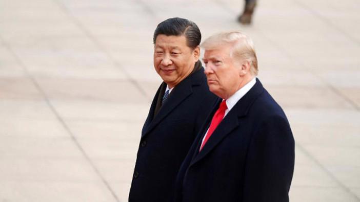 Chủ tịch Trung Quốc Tập Cận Bình (trái) và Tổng thống Mỹ Donald Trump trong lễ đón chính thức ông Trump thăm cấp nhà nước tới Trung Quốc tại Bắc Kinh, sáng 9/11 - Ảnh: Reuters.