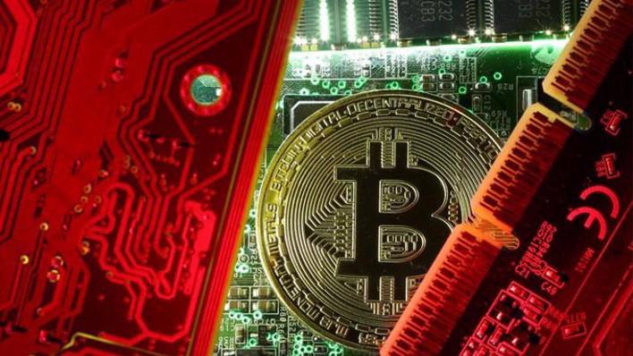 Hôm Chủ nhật, giá đồng tiền ảo lớn nhất thế giới hiện nay là Bitcoin đã lập kỷ lục mới 19.666 USD trên sàn Bitstamp có trụ sở ở Luxembourg. - Ảnh; Reuters.