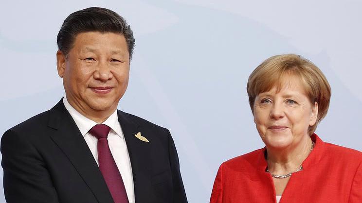 Chủ tịch Trung Quốc Tập Cận Bình (trái) và Thủ tướng Đức Angela Merkel.