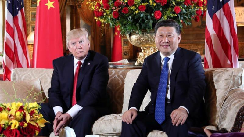 Tổng thống Mỹ Donald Trump (trái) và Chủ tịch Trung Quốc Tập Cận Bình trong cuộc gặp ở Florida vào tháng 4/2017 - Ảnh: Reuters.