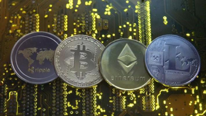Hình ảnh đại diện của một số đồng tiền kỹ thuật số hàng đầu thế giới hiện nay - Ảnh: Reuters.