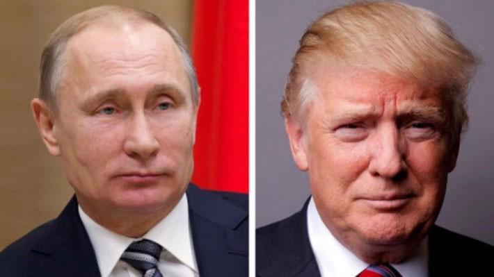 Tổng thống Nga Vladimir Putin (trái) và Tổng thống Mỹ Donald Trump - Ảnh: Reuters.