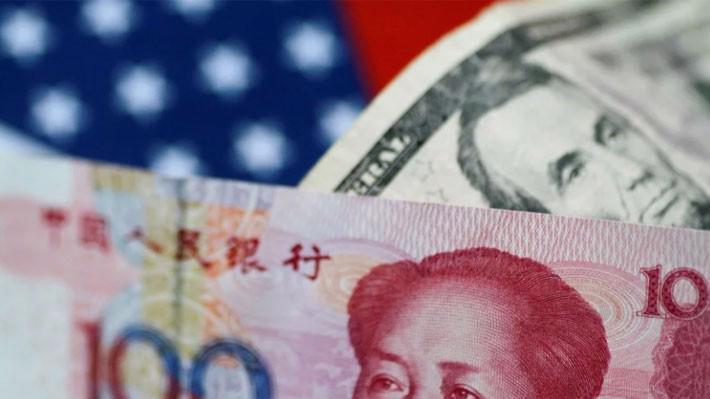 Nhân dân tệ đã để mất hết thành quả tăng giá từ đầu năm so với USD - Ảnh: Reuters/SCMP.
