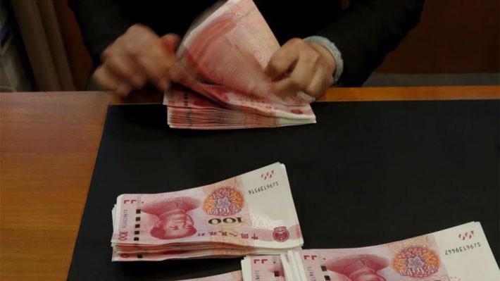 Nếu đồng Nhân dân tệ giảm giá thêm 10%, thì đó sẽ là một sự phủ nhận đối với những nỗ lực bình ổn tỷ giá thời gian qua của Bắc Kinh - Ảnh: Reuters/SCMP.