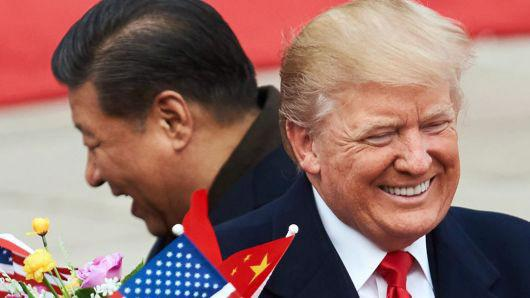 Chủ tịch Trung Quốc Tập Cận Bình (trái) và Tổng thống Mỹ Donald Trump - Ảnh: Tass/Getty/CNBC.