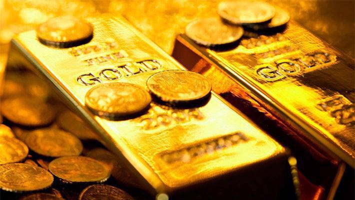 Đồng USD tăng giá đã đẩy giá vàng thế giới tuột khỏi mốc 1.200 USD/oz.