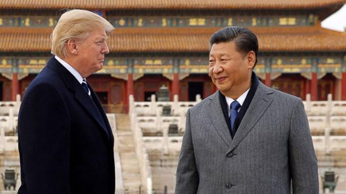 Tổng thống Mỹ Donald Trump (trái) và Chủ tịch Trung Quốc Tập Cận Bình trong chuyến thăm Bắc Kinh của ông Trump tháng 11/2017 - Ảnh: Reuters.