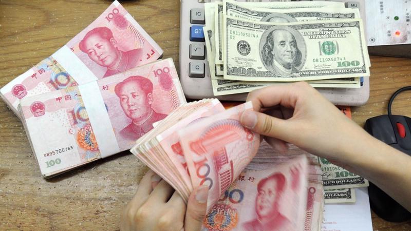 Đồng Nhân dân tệ đã mất giá hơn 6% trong năm nay so với đồng USD - Ảnh: WSJ.