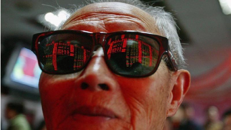 Chứng khoán Trung Quốc không nằm ngoài xu hướng giảm của thị trường toàn khu vực sáng 25/10 - Ảnh: BI.