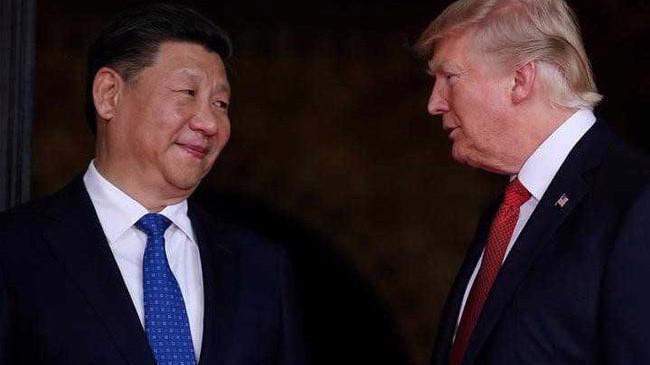 Chủ tịch Trung Quốc Tập Cận Bình (trái) và Tổng thống Mỹ Donald Trump.