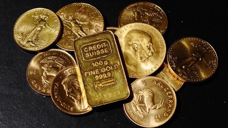 Giá vàng đang đứng trước ngưỡng cản khó vượt qua 1.300 USD/oz - Ảnh: Reuters/CNBC.