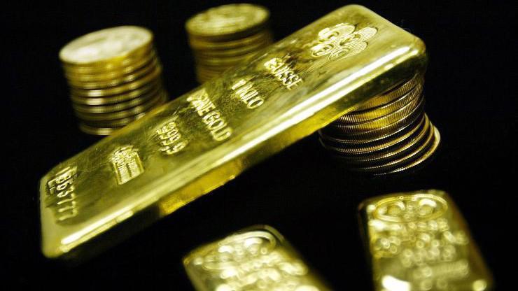 Tín hiệu từ FED và sự sụt giá của đồng USD giúp củng cố lực tăng cho giá vàng - Ảnh: Getty/CNBC.