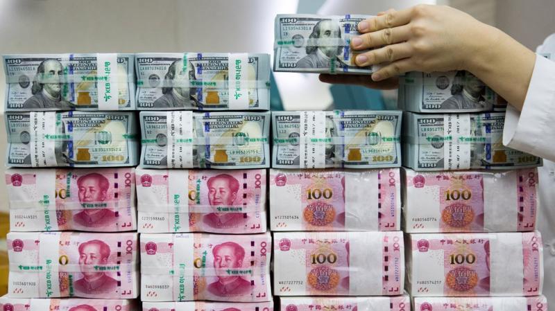 """Dù có thể khiến Mỹ """"khó chịu"""", đồng Nhân dân tệ giảm giá cũng gây ra nhiều thách thức đối với Trung Quốc."""