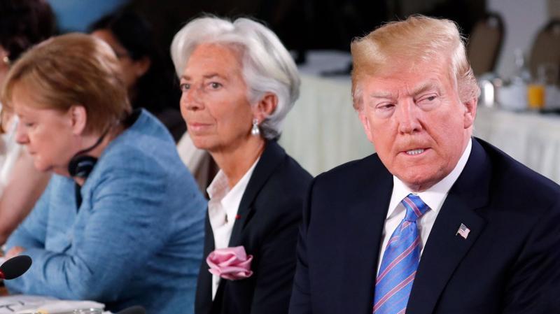 Từ phải qua: Tổng thống Mỹ Donald Trump, Tổng giám đốc Quỹ Tiền tệ Quốc tế (IMF) Christine Lagarde, và Thủ tướng Đức Angela Markel tại thượng đỉnh khối G7 ở Quebec, Canada, tháng 6/2018 - Ảnh: Reuters.