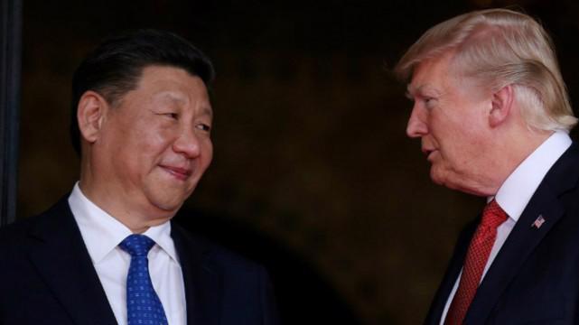 Chủ tịch Trung Quốc Tập Cận Bình (trái) và Tổng thống Donald Trump - Ảnh: Reuters.