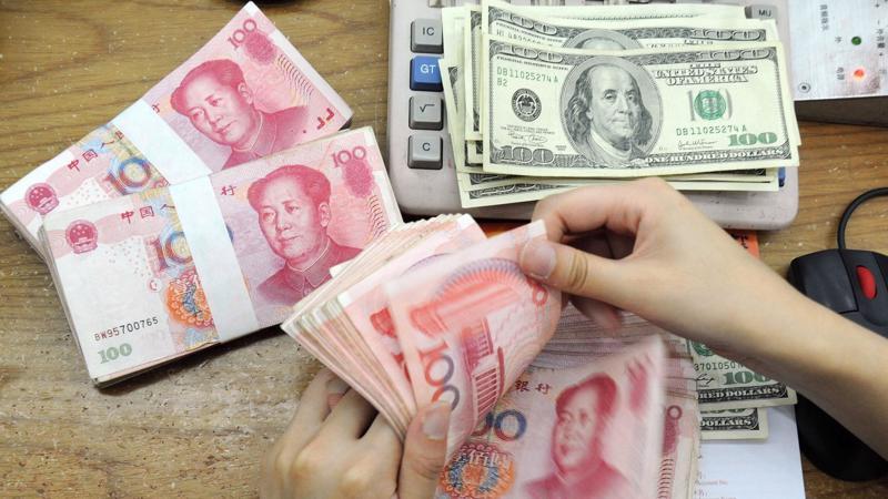 Mốc tỷ giá 7 Nhân dân tệ đổi 1 USD đang bị thử thách - Ảnh: WSJ.