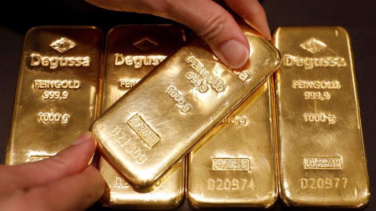 Hiện tại, giá vàng thế giới tương đương gần 41,8 triệu đồng lượng nếu được quy đổi theo giá USD tự do - Ảnh: Reuters.