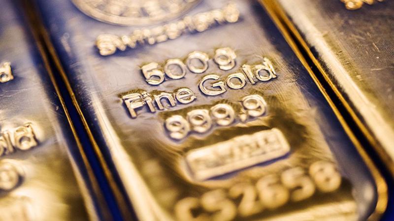 Giá vàng thế giới chưa tái lập được mốc 1.500 USD/oz - Ảnh: Bloomberg.