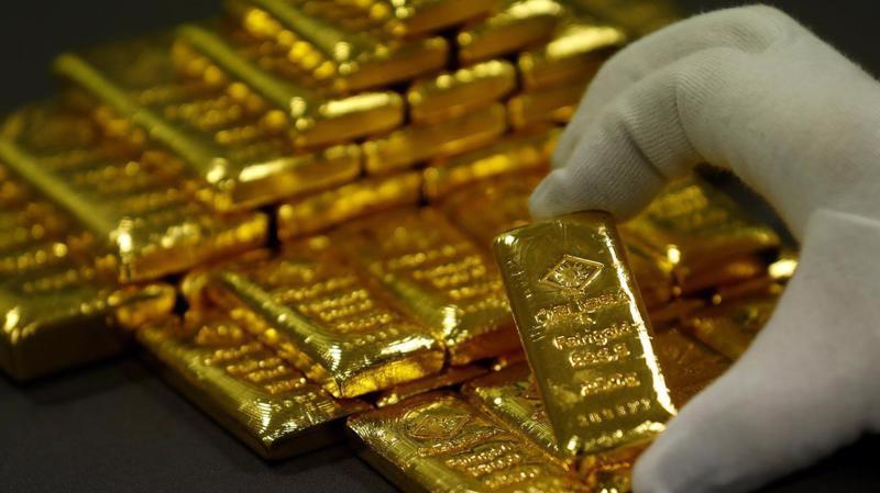 Tuần này, giá vàng thế giới giảm 0,7%, đánh dấu tuần giảm thứ ba liên tiếp - Ảnh: Reuters.