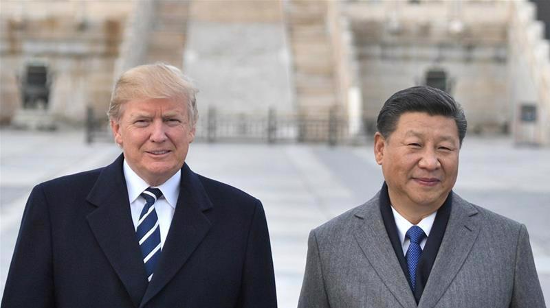 Tổng thống Mỹ Donald Trump (trái) và Chủ tịch Trung Quốc Tập Cận Bình trong chuyến thăm Bắc Kinh cuối năm 2017 của ông Trump - Ảnh: Reuters.