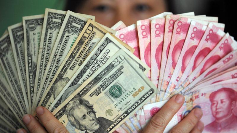 Tỷ giá Nhân dân tệ so với USD giảm mạnh trong quý 3 - Ảnh: Tân Hoa Xã.