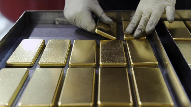 Vàng thế giới chững giá dưới 1.500 USD/oz do giới đầu tư chờ những thông tin mới - Ảnh: Reuters/CNBC.