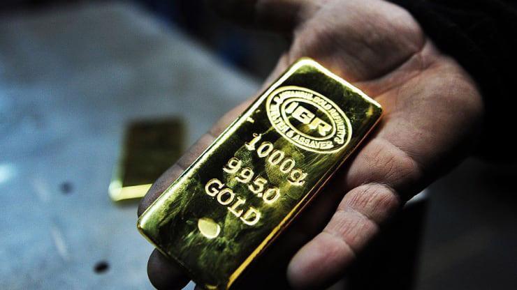 Giá vàng quốc tế hiện vẫn tăng 14% so với đầu năm - Ảnh: Getty/CNBC.