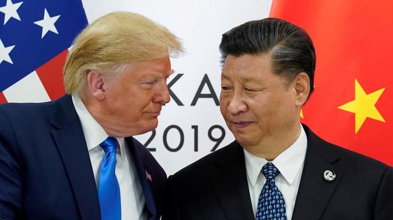 Tổng thống Mỹ Donald Trump (trái) và Chủ tịch Trung Quốc Tập Cận Bình trong cuộc gặp ở Nhật Bản, tháng 6/2019 - Ảnh: Reuters.