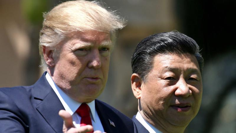 Tổng thống Mỹ Donald Trump (trái) và Chủ tịch Trung Quốc Tập Cận Bình - Ảnh: Reuters.