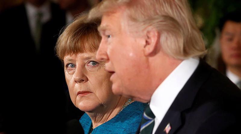 Thủ tướng Đức Angela Merkel và Tổng thống Mỹ Donald Trump trong cuộc gặp ở Washington hồi tháng 3/2017 - Ảnh: Reuters/RT.<br>