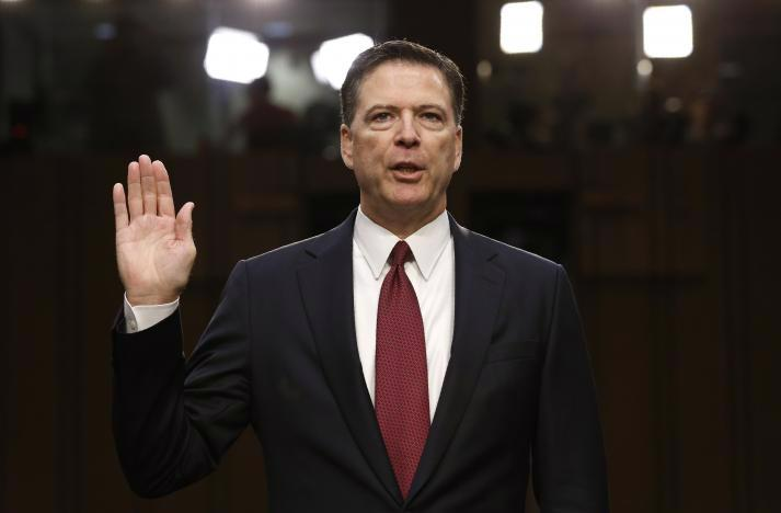 Cựu Giám đốc FBI James Comey trong phiên điều trần ngày 8/6 - Ảnh: Reuters.<br>