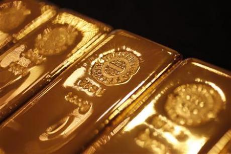 Vùng cản 1.280-1.285 USD/oz đang tỏ ra khá mạnh đối với giá vàng - Ảnh: Reuters.