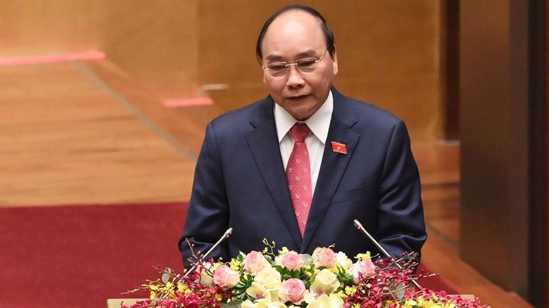 Thủ tướng Chính phủ Nguyễn Xuân Phúc trình bày báo cáo công tác nhiệm kỳ Chính phủ tại Kỳ họp 11 Quốc hội khóa 14 - Ảnh: VGP