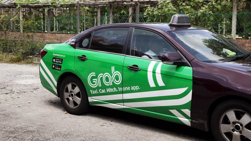Grab đang hoạt động tại 178 thành phố ở Đông Nam Á - Ảnh: Bloomberg.